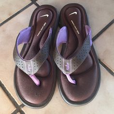 Nike Comfort Footbed Sandals Comfortable flip flop sandals!! Brown & purple!! New...but there is a little snag on the right foot toe area...see pics! Will fit 7 1/2 & 8 Nike Shoes