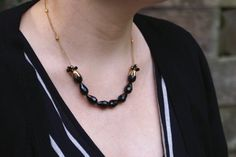 Black faceted teardrop beads and gold chain necklace by SCBeads
