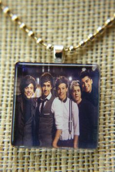 One Direction- Whole Group- Glass Tile Jewelry Pendant with FREE CHAIN and Organza Gift Bag. $8.00, via Etsy.