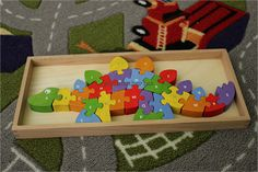 Begin Again wooden dinosaur puzzle; eco-friendly toys alphabet