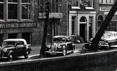1950's. 1938 Lancia Aprilia Cabriolet (G-52292) parked in front of Drukkerij Jacob Van Campen on the Oudezijds Voorburgwal in Amsterdam. Photo Stadsarchief Amsterdam #amsterdam #1950 #OudezijdsVoorburgwal