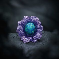 Chopard Fleurs d'Opales high jewellery ring in white gold and titanium set with purple sapphires, amethysts, tsavorites and a 24ct black opal.