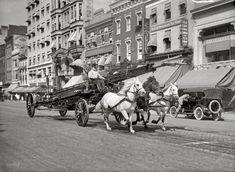 "Washington, D.C., circa 1914. ""Three-horse team pulling water tower."" A fire truck racing past the Tea Cup Inn on F Street. Harris & Ewing"