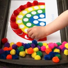 This craft adds a nice splash of color to any gray day! After you've made your rainbow, use colored popoms as game pieces for a color matching game.