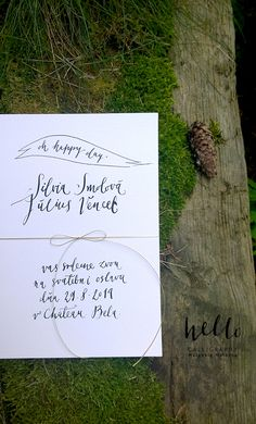 simple, white invitation with thin, gold twine by HELLO calligraphy .Małgosia Małecka.