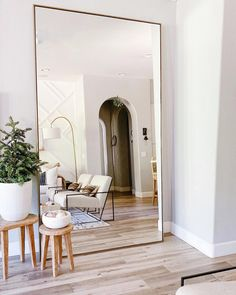 Handcrafted by Indonesian artisans, our simply chic Linnea mirror collection features a versatile, contemporary aesthetic. Minimalist steel frames are finished […] Home Living Room, Apartment Living, Living Room Decor, Bedroom Decor, Living Spaces, Big Mirror In Bedroom, Big Mirrors, Large Mirror Living Room, Giant Mirror