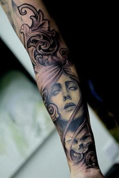 tattoo- this could be the buddha's face from the smoke.