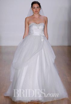"""Brides.com: Disney Fairy Tale Weddings by Alfred Angelo - 2014. Style 235, """"Belle"""" satin, glitter net and net ball gown wedding dress with rhinestones, crystal beading, sequins, pearls, glitter net, organza and satin flowers, Alfred Angelo"""