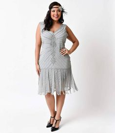 For those who adore vintage dresses that stand out from the crowd, youll love the artistic appeal of the silver plus size Aelita flapper from Unique Vintage! This art deco drenched plus size flapper dress boasts a knee-length shift style silhouette in a
