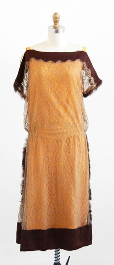 vintage 1920s silk + chantilly lace dress with fur trim.