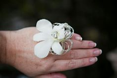 White orchid prom ring with rhinestone In Bloom Florist, Prom Flowers, White Orchids, Rings, Ring, Wire Wrapped Rings