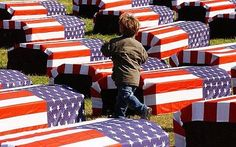 US flag-coffins: US to overturn media ban on flag-draped coffin images!  It is about time.  This young boy may have LOST his Dad or uncle.  How sad.