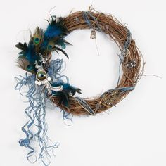 Solid Oak Steam Punk! Not just for jewelry any more. Check out this grapevine wreath made with Steam Punk peacock charms and feathers, along with real feathers, raffia, and a few extra charms.