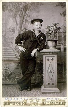 """Vintage cabinet card photo of a sailor identified as """"Roy in Hong Kong"""" by A. Cheong Photographer"""