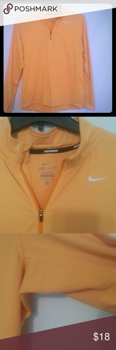 Nike shirt D ri - fir Nike running shirt kind of a dull orange. Has a little wear. Small green stains on back see last pic it's so small the camera couldn't get it . Has a few fuzz balls .  Soft material. Nike Tops Tees - Long Sleeve