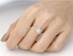 A very delicate and unique snowflake Adjustable Ring that is perfect for the winter season. Bringing just enough sparkle to the hand. A lovely