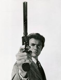"""Harry Callaham. Waiting for someone to make his day. Dirty Harry. '71."" - with the biggest handgun in the world? Back then the .44 magnum was powerful, but now we have the .454 Casule, .460 S, and the .500 S to name a few in my collection even in liberal anti-gun California. To bad they outlawed the Desert Eagle .50 AE, and all handguns that fire rifle rounds ~;^/>"
