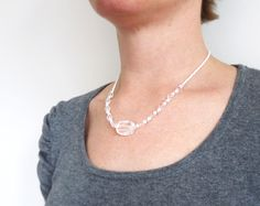 Short necklace with clear quartz stone an glass. by tline