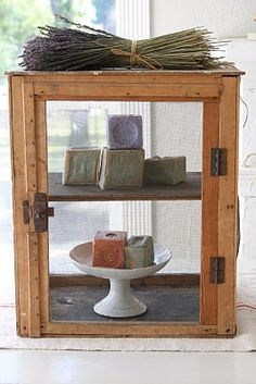 a vintage pie safe used to display soaps, could also use a display cabinet or make one