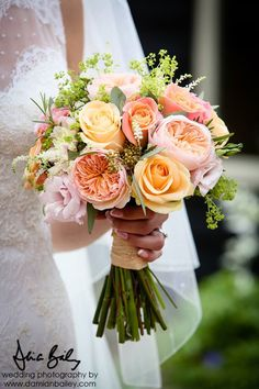 Bridal bouquet of Miss Piggy roses, peach avalanche roses, Juliet David Austin roses, champagne lisianthus, pale pink lisianthus, rosemary, alchemilla mollis and white astible - Bury Court Barn