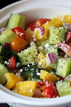 Fresh Mixed Veggie Salad... Cucumbers, cherry tomatoes, red onion, salt, pepper & EVOO.. So simple and fresh... Maybe add some mango and lime! Can't wait to try it.