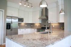 Image result for thunder white granite with white cabinets
