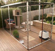 Cat enclosure outside with toys and box. #catsdiyenclosure