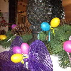 Super simper Easter mantle for about $5.00. Simple tie a bow and add some sparkly eggs.