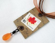 This postage stamp #jewelry #tutorial is an easy and fun way to preserve and enjoy the beautiful artwork on stamps.