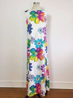 ABOUT: Trippy flower power maxi gown with Hawaiian vibes c. 1960s. Sleeveless with long 29 slits up the side, which makes this dress a great candidate for afternoons at the pool or beach! Would make a great cover up/lounging piece!  TAG: n/a SIZE: n/a FITS LIKE: Medium to Large depending on fit. Bust can fit approx. 38  *NO REFUNDS DUE TO IMPROPER FIT. COMPARE MEASUREMENTS BELOW TO A LIKE ITEM IN YOUR OWN CLOSET WHICH ALREADY FITS. NO REFUNDS WILL BE GIVEN IF AN ITEM DOES NOT F...