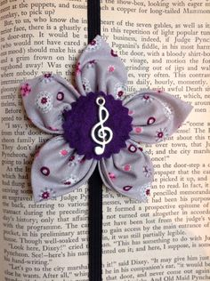 Flower headband/bookmark with treble clef charm on Etsy, $11.00