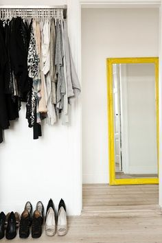 LE FASHION BLOG OPEN CLOSETS PART 2 HOME DECOR IDEAS FASHIONABLE HOME INSPIRATION CLOTHES ON DISPLAY BRIGHT YELLOW FRAMED FLOOR MIRROR SIMPL...