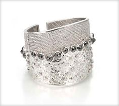 Trinity 20k motion cuff in white gold with black and white diamonds.