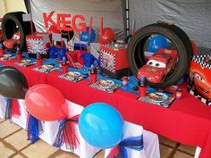 http://may3377.blogspot.com - Love the Lightning McQueen pinata in the tire!  Fab Cars 2 party!