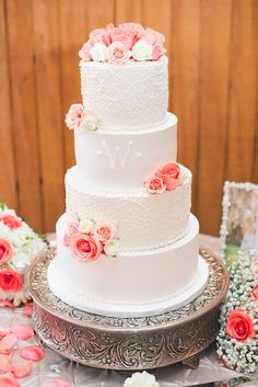Detailed White Wedding Cake With Coral Roses | Bavarian Cakery https://www.theknot.com/marketplace/bavarian-cakery-houston-tx-820788 | Striking Stems | Designs By Karinda