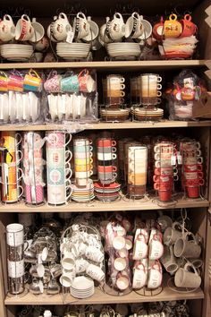 Coffee shop. Eclectic cups.  How fun...maybe I could have a random asortment of cups to serve coffee in or just to decorate...