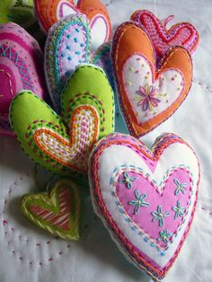 darling needlework hearts--could be good sachets!