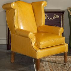 Randall Tysinger Gold Leather Wing Chair by EJ Victor. Classic design with a bright color flair! Love it!!