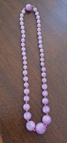 """Vintage bead necklace from the 1950's with #lavender moonglow beads. 16""""  with slide and clip clasp.  Beads graduate from 1/4"""" to 5/8"""".  Hand knotted.  Wonderful vintage con... #1950s #gvs"""