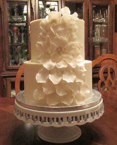Fondant rose petals on buttercream iced cake
