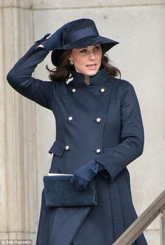 The duchess wore a dark blue coat for the occasion