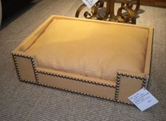 Could tottallly DIY this nail head studded dog bed!