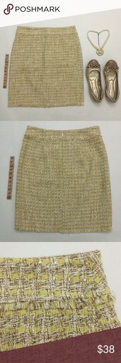 "Ann Taylor yellow and gold pencil skirt Pencil skirt with yellow, gold, off-white, and white woven strands, size 2 petite, non-elastic waistband, 18.5"" overall length, 13.5"" waist across lying flat, off-white inner lining, 70% cotton/30% polyester skirt, 100% polyester lining, dry clean only. Back zipper, no pockets. Brand new with tags so it's in excellent new condition. No damage/fraying/stains. Has been stored in a non-smoking/pet-free home. Necklace, shoes not included. No trades or PP…"