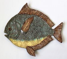 12 inches wide; brown clay with Gunmetal green, shino, and yellow glazes     I wish I could make these plates life-sized... Opah's grow to...