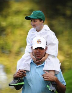 Bo Van Pelt carries his son Crew, 4, now 5. Bo pushed Tiger right up to the 16th hole when the crowd pressure finally did him in. At the AT and T National July 1, 2012.