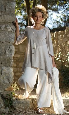 AMALTHEE CREATIONS  Asymetric linen jersey tunic pale gray color, white linen large pants   Necklace: zebu horn with calligraphy paper, bone beads and conus shell from Mauritania