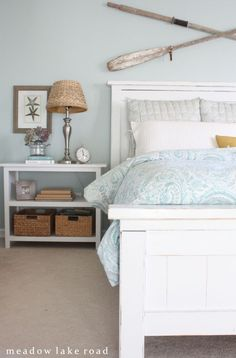 Calm, beachy master bedroom tour | www.meadowlakeroad.com. Nice crossed oars above headboard.