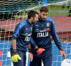 Gianluigi Donnarumma and Gianluigi Buffon (L) chat during the training session at the club's training ground at Coverciano on November 10, 2016 in Florence, Italy.