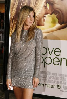 """""""LOVE HAPPENS"""" PREMIERE, 2009 Aniston sparkled in a super-short silver Valentino mini-dress, showing off her famous legs and age-defying body."""