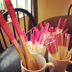Easy way to jazz up cheap plastic spoons for a party: dip the ends in colorful paint!